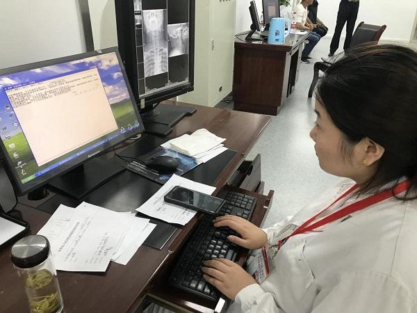 图11.医学影像科张庆护士记录工作要点.jpg